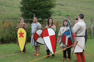 visitors holding saxon shields